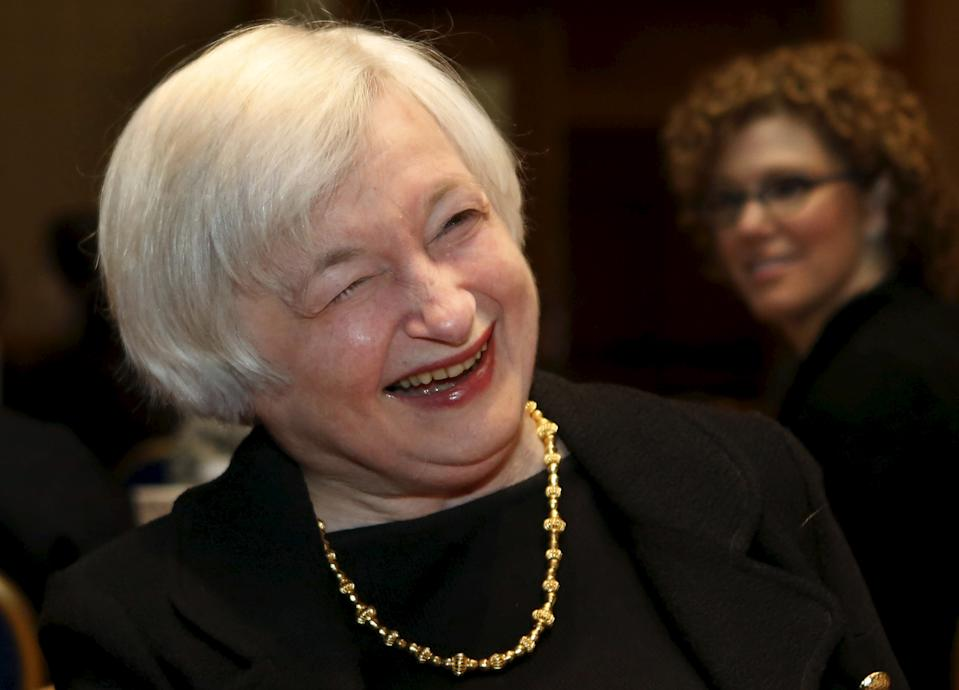 Federal Reserve Chair Janet Yellen smiles at the Federal Reserve's ninth biennial Community Development Research Conference focusing on economic mobility in Washington April 2, 2015. More research is needed to understand what policies allow people to move up the economic ladder and what holds them back, Yellen said on Thursday, returning to a controversial topic for the U.S. central bank. REUTERS/Yuri Gripas