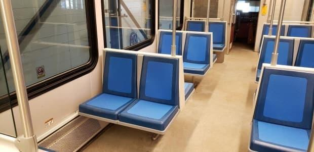 The old fabric seats are being replaced by these blue seats, which are made up of a harder rubber type material that includes a germ-killing additive. (Edmonton Transit Service - image credit)