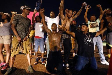 Demonstrators block traffic to protest the shooting death of Alton Sterling near the headquarters of the Baton Rouge Police Department in Baton Rouge, Louisiana