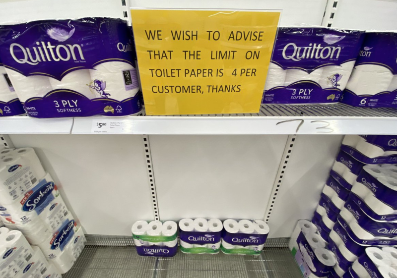 A picture taken in a Coles shows a sign informing customers they can only buy four packs of toilet paper. Source: 7 News.