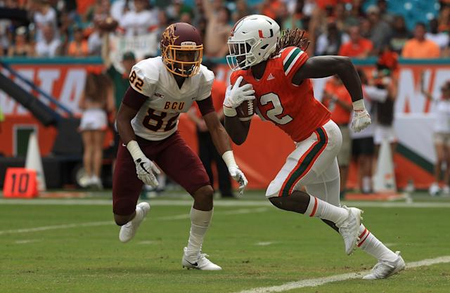 "MIAMI GARDENS, FL – SEPTEMBER 02: <a class=""link rapid-noclick-resp"" href=""/ncaaf/players/267330/"" data-ylk=""slk:Malek Young"">Malek Young</a> #12 of the Miami Hurricanes returns an interception during a game against the <a class=""link rapid-noclick-resp"" href=""/ncaab/teams/bag/"" data-ylk=""slk:Bethune Cookman Wildcats"">Bethune Cookman Wildcats</a> at Hard Rock Stadium on September 2, 2017 in Miami Gardens, Florida. (Photo by Mike Ehrmann/Getty Images)"