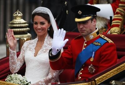 Their Royal Highnesses Prince William Duke of Cambridge and Catherine Duchess of Cambridge make the journey by carriage procession to Buckingham Palace following their marriage at Westminster Abbey in London on April 29, 2011  -- Getty Images