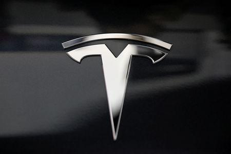 FILE PHOTO: A Tesla logo is seen in Los Angeles, California U.S. January 12, 2018. REUTERS/Lucy Nicholson/File Photo