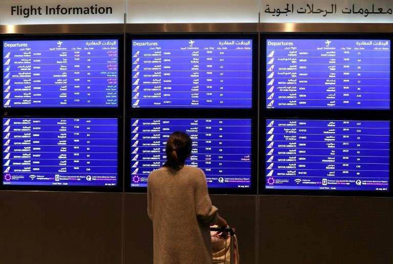 A passenger checks the departures board at the Hamad International Airport in Doha, Qatar in this file picture taken on March 7, 2017