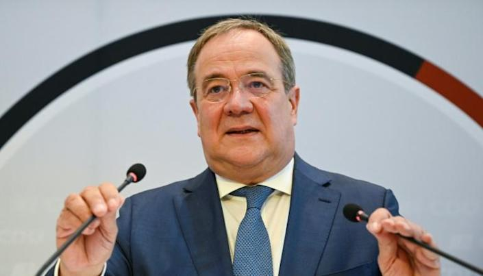 With the conservative CDU and CSU parties facing possibly their worst election result in post-war Germany, Armin Laschet needs all the motivation he can get (AFP/THOMAS KIENZLE)