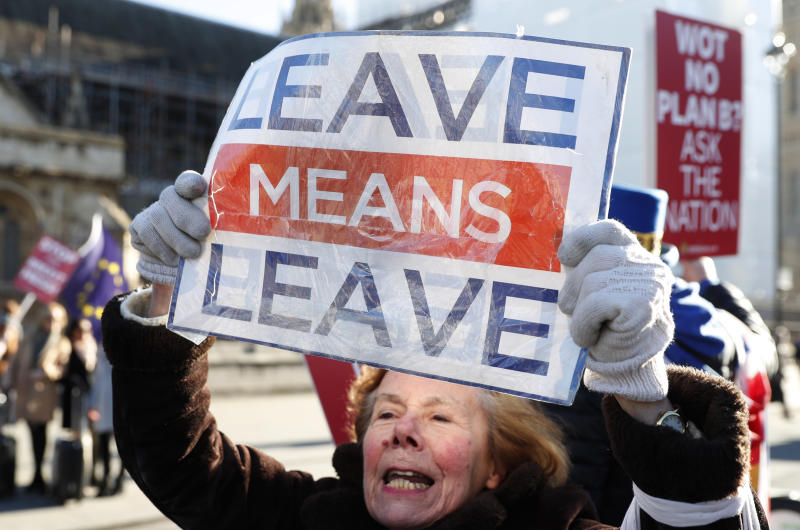 Pro and Anti Brexit protesters demonstrate outside the Houses of Parliament in London, Monday, Jan. 28, 2019. British Prime Minister Theresa May faces another bruising week in Parliament as lawmakers plan to challenge her minority Conservative government for control of Brexit policy. (AP Photo/Alastair Grant)