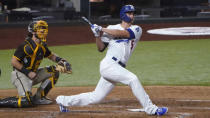 Los Angeles Dodgers' Corey Seager watches the flight of his two-RBI double off San Diego Padres starting pitcher Zach Davies during the third inning in Game 2 of a baseball National League Division Series Wednesday, Oct. 7, 2020, in Arlington, Texas. (AP Photo/Sue Ogrocki)