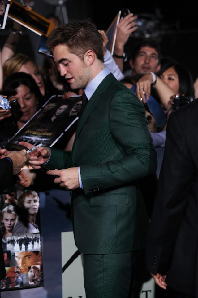 """Robert Pattinson greets fans at """"The Twilight Saga: Breaking Dawn - Part 2"""" Los Angeles premiere at the Nokia Theatre L.A. Live on November 12, 2012 in Los Angeles, California."""