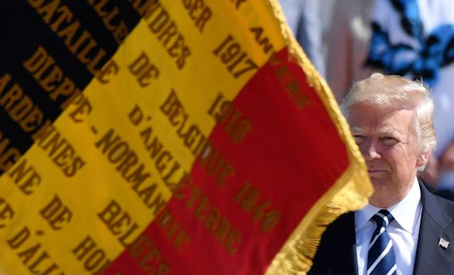 <p>A Belgian flag blows in front of President Donald Trump as he arrives at Melsbroek Military Airport in Melsbroek, Belgium on Wednesday, May 24, 2017. President Trump is in Belgium to attend a NATO summit and to meet EU and Belgian officials. (Photo: Geert Vanden Wijngaert/AP) </p>