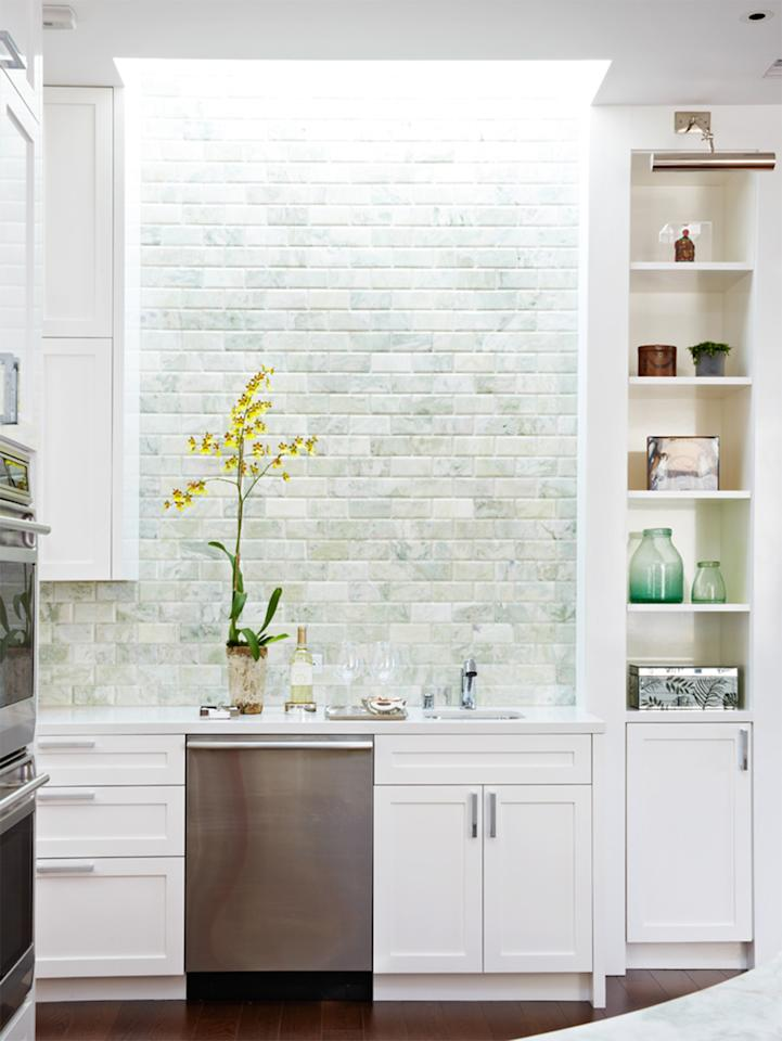"""<p><a href=""""https://www.marthastewart.com/1520793/tile-design-ideas"""">Subway tiles</a> work well in nearly any kitchen&mdash;but if you want something a little more unexpected, focus on placement. """"The subway tile has long been, and continues to be, a classic,"""" says interior designer <a href=""""https://www.annehepfer.com"""">Anne Hepfer</a>. """"For a more traditional or transitional look, stagger. For more contemporary look, stack or soldier.""""</p>"""