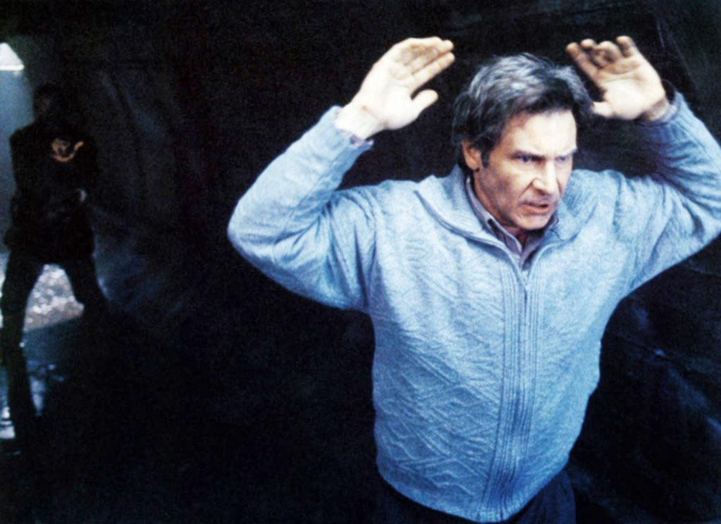 """<a href=""""http://movies.yahoo.com/movie/1803453994/info"""">The Fugitive</a> (1993): This is one of those regular-guy-in-danger roles that are Ford's bread and butter. Based on the 1960's TV series, the film stars Ford as Dr. Richard Kimble, who was wrongly convicted of killing his wife. When the bus he's riding in crashes on the way to prison, he makes his escape. His intensity, paranoia and fear are palpable. But Ford also functions as the straight man here compared to Tommy Lee Jones as the quick-witted lead investigator on his tail. Both performances give the film a depth beyond the usual summer chase thriller. But that contrast also sets up this classic exchange once their paths cross: """"I didn't kill my wife."""" """"I don't care."""""""