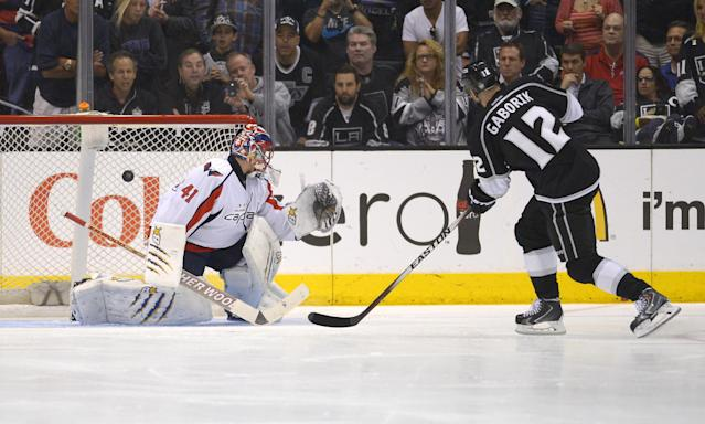 Los Angeles Kings right wing Marian Gaborik, right, of Slovakia, scores on Washington Capitals goalie Jaroslav Halak, of Slovakia, during an overtime shootout period of an NHL hockey game, Thursday, March 20, 2014, in Los Angeles. The Kings won 2-1 in an overtime shootout. (AP Photo/Mark J. Terrill)