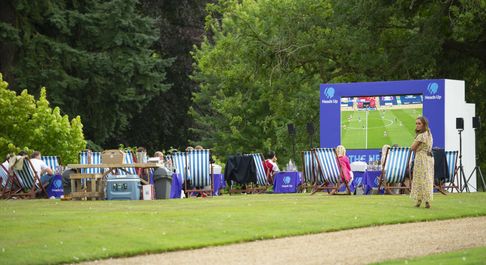 KING'S LYNN, ENGLAND - AUGUST 01: People watch the match as Prince William, Duke of Cambridge hosts an outdoor screening of the Heads Up FA Cup final on the Sandringham Estate on August 1, 2020 in King's Lynn, England. (Photo by Tim Merry - WPA Pool/Getty Images)