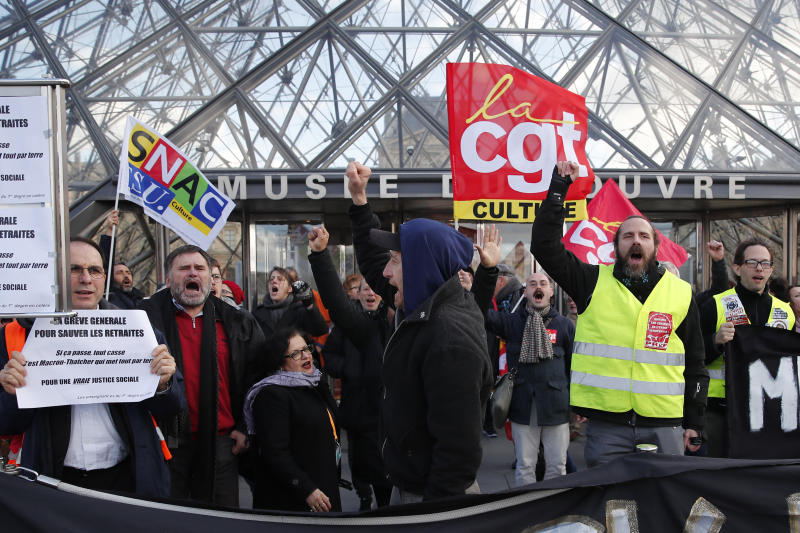 Striking employees demonstrate outside the Louvre museum Friday, Jan. 17, 2020 in Paris. Paris' Louvre museum was closed Friday as dozens of protesters blocked the entrance to denounce the French government's plans to overhaul the pension system. (AP Photo/Francois Mori)