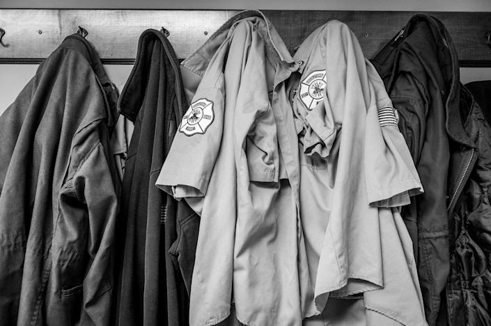 <p>Coat rack at the Middletown Fire Department. A federal grant last year allowed them to bring on the additional personnel necessary to deal with the growing number of calls. (Photograph by Mary F. Calvert for Yahoo News) </p>