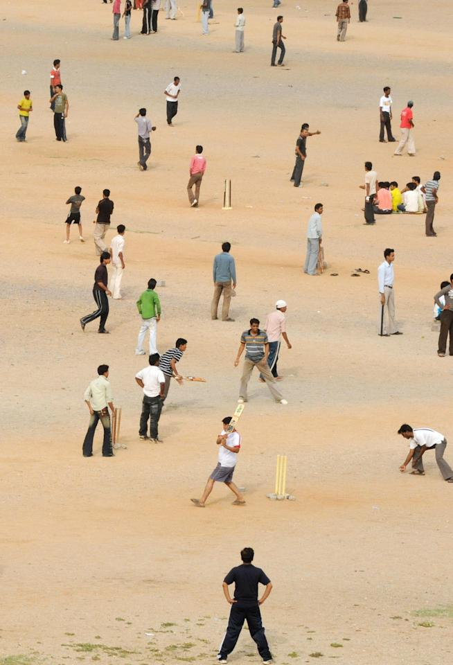 Indian youths play cricket at the NTR grounds in Hyderabad on May 24, 2009. Recreational cricketers, numbering as many as 50 teams, converge on the grounds to play gully (street) cricket on Sundays, which has seen a resurgence following the popularity of Twenty20 cricket. Hyderabad's Deccan Chargers will play Royal Challengers Bangalore in the IPL Twenty20 finals match on May 24 in South Africa. AFP PHOTO/Noah SEELAM (Photo credit should read NOAH SEELAM/AFP/Getty Images)
