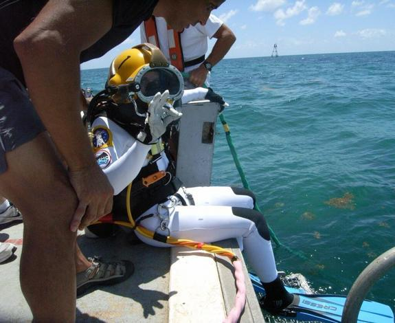 NASA astronaut Kate Rubins just before diving into the water en route to the Aquarius underwater laboratory. Rubins was on the SEATEST aquanaut crew that worked in the lab in September 2013.
