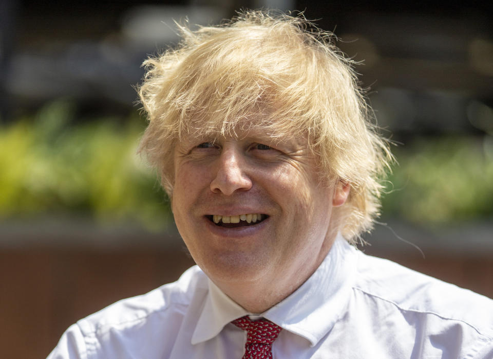 LONDON, ENGLAND - JUNE 26: British Prime Minister Boris Johnson during a visit to Pizza Pilgrims in West India Quay, London Docklands, as they prepare to reopen as lockdown rules are eased on July 4th, on June 26, 2020 in London, England. (Photo by Heathcliff O'Malley - WPA Pool/Getty Images)