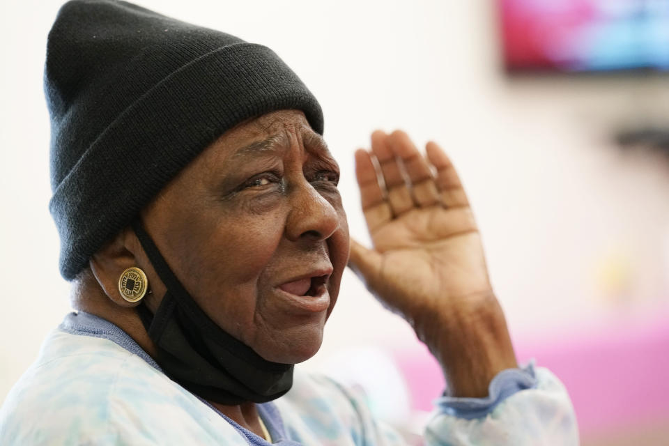 P.M. Browner, 88, speaks about her apprehension over receiving a COVID-19 vaccine while waiting for a transportation bus at the Rev. S.L.A. Jones Activity Center for the Elderly to take her and other seniors to the Aaron E. Henry Community Health Service Center to receive a vaccination, Wednesday, April 7, 2021, in Clarksdale, Miss. The Mississippi Department of Human Services is in the initial stages of teaming up with community senior services statewide to help older residents get vaccinated. (AP Photo/Rogelio V. Solis)