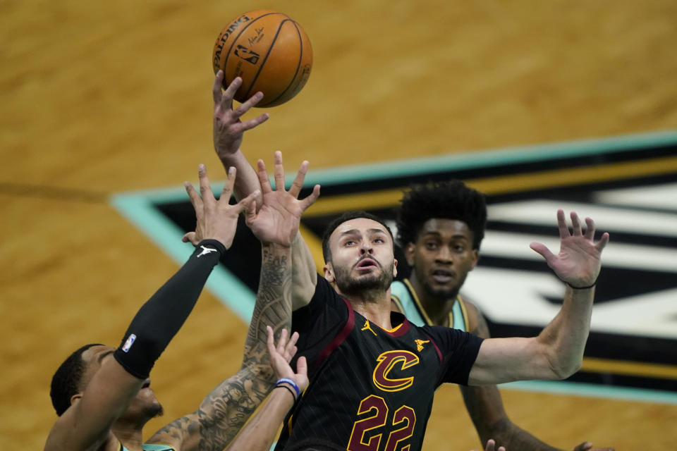 Cleveland Cavaliers forward Larry Nance Jr. pulls a rebound away from Charlotte Hornets forward Miles Bridges during the first half of an NBA basketball game on Friday, April 23, 2021, in Charlotte, N.C. (AP Photo/Chris Carlson)