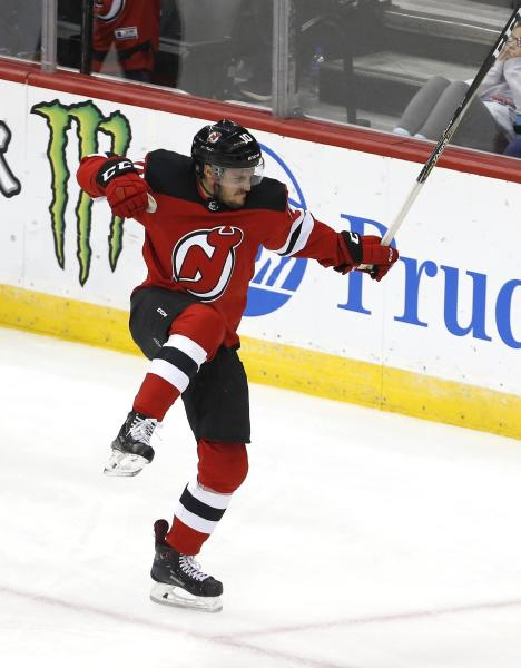 New Jersey Devils center Jean-Sebastien Dea (10) celebrates after scoring a goal against San Jose Sharks during the third period of an NHL hockey game, Sunday, Oct. 14, 2018, in Newark, N.J. (AP Photo/ Noah K. Murray)