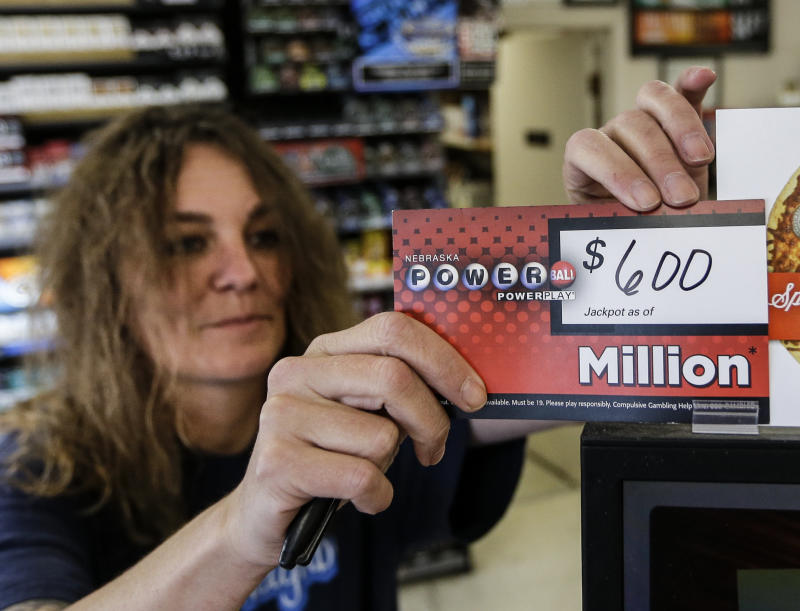 Sheila Sutton updates the Powerball prize money sign at the Super C convenience store in Lincoln, Neb., Friday, May 17, 2013. Powerball officials say the jackpot has climbed to an estimated $600 million, making it the largest prize in the game's history and the world's second largest lottery prize.  Sutton sold a million dollar powerball ticket on Tuesday. (AP Photo/Nati Harnik)