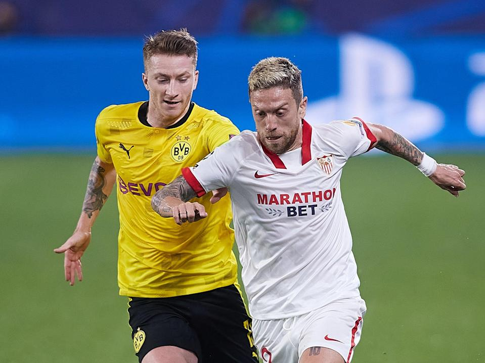 Alejandro Papu Gomez (left) of Sevilla vies for the ball with Borussia Dortmund's Marco Reus (Getty Images)