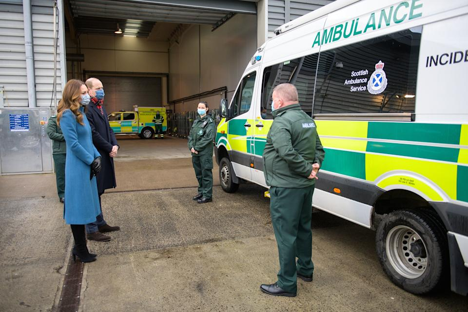 Britain's Prince William, Duke of Cambridge (2nd L) and Britain's Catherine, Duchess of Cambridge (L) speak with staff during a visit to the Scottish Ambulance Service Response Centre in Newbridge, west of Edinburgh in Scotland on December 7, 2020, on their first full day of engagements on their tour of the UK. - During their trip, their Royal Highnesses hope to pay tribute to individuals, organisations and initiatives across the country that have gone above and beyond to support their local communities this year. (Photo by Wattie Cheung / POOL / AFP) (Photo by WATTIE CHEUNG/POOL/AFP via Getty Images)