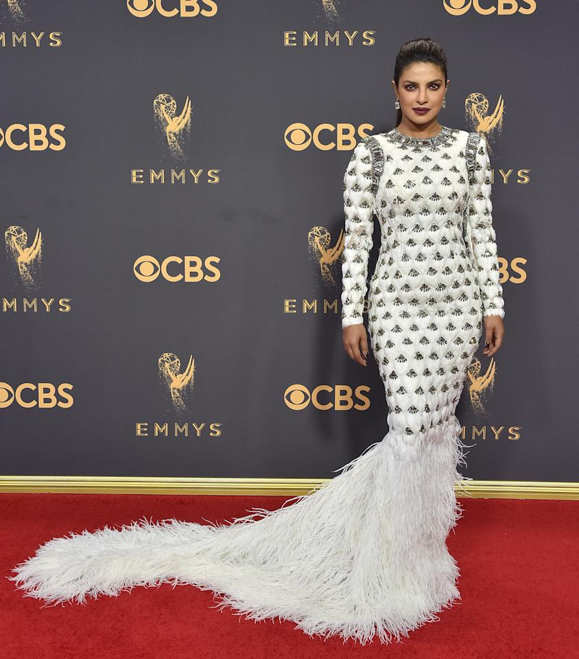 <p>Priyanka Chopra walked the red carpet of the 69th Annual Primetime Emmy Awards with confidence, but not even her natural beauty could save this look. From the sleeves to the feathered skirt, this gown was working overtime, doing everything but land Chopra on the Best Dressed List. While we love the white against Chopra's beautiful skin, the dress does nothing to flatter her figure. It can be hard to translate runway to the red carpet, and this is a prime example of a red carpet fashion flop. </p>