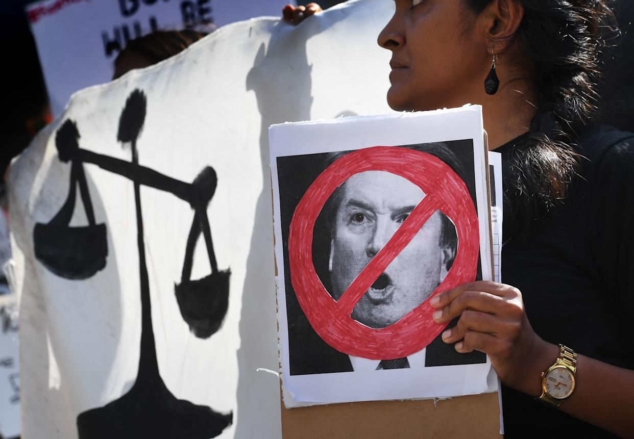 Demonstrators in Los Angeles hold anti-Kavanaugh signs and banners on Sept. 28, one day after Christine Blasey Ford testified before the Senate Judiciary Committee concerning Supreme Court nominee Brett Kavanaugh. The ACLU says her testimony was credible. (Photo: MARK RALSTON via Getty Images)