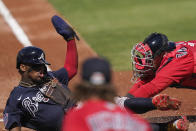 Atlanta Braves' Ronald Acuna Jr., (13) safely slides into home plate against Boston Red Sox catcher Jett Bandy in the first inning during a spring training baseball game on Monday, March 1, 2021, in Fort Myers, Fla. (AP Photo/Brynn Anderson)