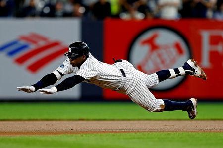 FILE PHOTO: Oct 9, 2018; Bronx, NY, USA; New York Yankees shortstop Didi Gregorius (18) dives into second base for a double during the fourth inning against the Boston Red Sox in game four of the 2018 ALDS playoff baseball series at Yankee Stadium. Mandatory Credit: Noah K. Murray-USA TODAY Sports
