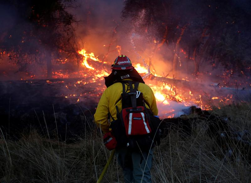 A new federal report predicts states in the Southwest would be more vulnerable to expensive, deadly  wildfires as climate change continues. (Jim Urquhart / Reuters)