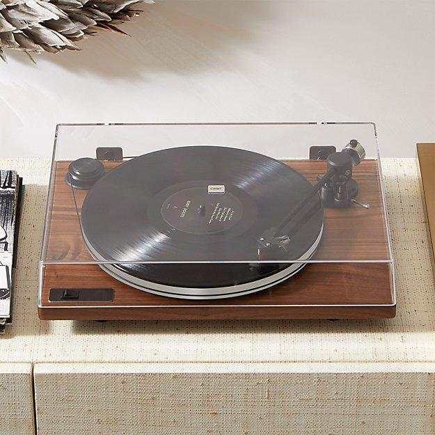 "<p>Go back in time to a classic musical affair with the <a href=""https://uturnaudio.com/products/orbit-special-turntable"" rel=""nofollow noopener"" target=""_blank"" data-ylk=""slk:U-Turn Audio Orbit Special Turntable With Built-In Preamp"" class=""link rapid-noclick-resp"">U-Turn Audio Orbit Special Turntable With Built-In Preamp</a>. Since you're no longer budgeting for concerts or music festivals, why not treat yourself to the chic record player you've always wanted?</p> <p>Unlike most budget-friendly players, U-Turn Audio sets itself apart with its sleek, non-bulky design. It also features an acrylic platter that not only produces more consistent and clear playback, it's an elegant look that works with any aesthetic.</p> $549, CB2. <a href=""https://www.cb2.com/orbit-special-walnut-turntable-with-built-in-pre-amp/s433134"" rel=""nofollow noopener"" target=""_blank"" data-ylk=""slk:Get it now!"" class=""link rapid-noclick-resp"">Get it now!</a>"