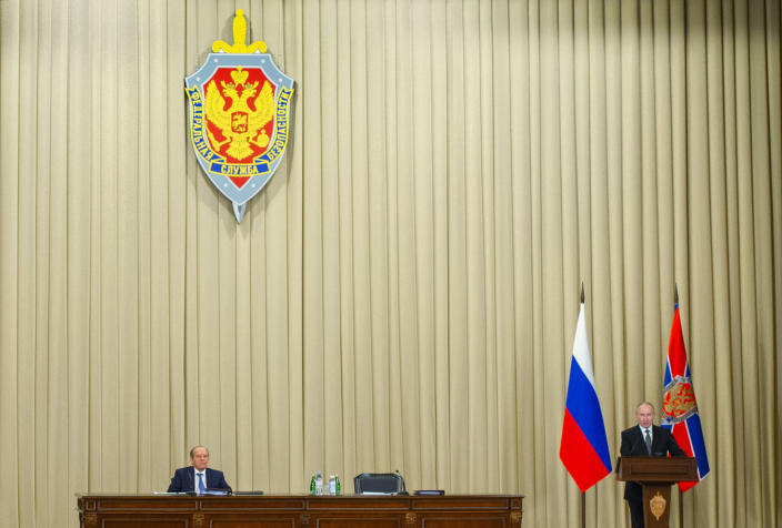 Russian President Vladimir Putin, right, and Federal Security Service Director Alexander Bortnikov attend a meeting of the Federal Security Service (FSB) board in Moscow, Russia, on Wednesday, Feb. 24, 2021. (Alexei Druzhinin, Sputnik, Kremlin Pool Photo via AP)