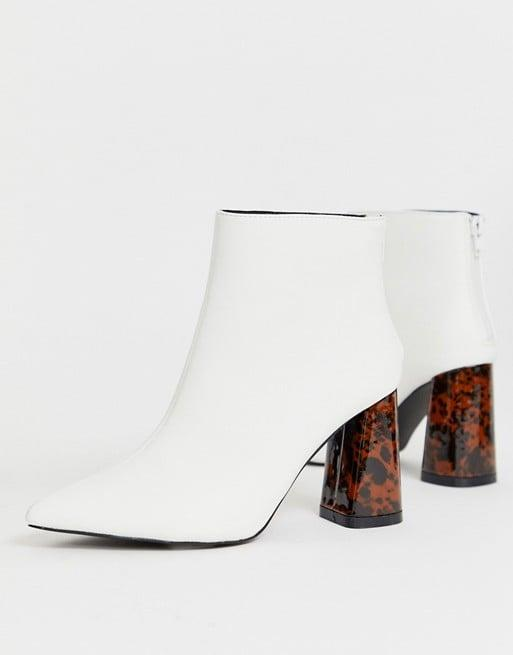 "<p>We love the tortoise shell heels on these <a href=""https://www.popsugar.com/buy/ZCodeZ-Exclusive-Nura-Boots-493820?p_name=Z_Code_Z%20Exclusive%20Nura%20Boots&retailer=asos.com&pid=493820&price=60&evar1=fab%3Aus&evar9=46671816&evar98=https%3A%2F%2Fwww.popsugar.com%2Ffashion%2Fphoto-gallery%2F46671816%2Fimage%2F46671950%2FZCodeZ-Exclusive-Nura-Boots&list1=shopping%2Cfall%20fashion%2Cshoes%2Cboots&prop13=api&pdata=1"" rel=""nofollow"" data-shoppable-link=""1"" target=""_blank"" class=""ga-track"" data-ga-category=""Related"" data-ga-label=""https://www.asos.com/us/zcodez/zcodez-exclusive-nura-white-tortoishell-heeled-ankle-boots/prd/12836448?clr=white-tort&amp;colourWayId=16467539&amp;SearchQuery=white%20boots"" data-ga-action=""In-Line Links"">Z_Code_Z Exclusive Nura Boots</a> ($60).</p>"