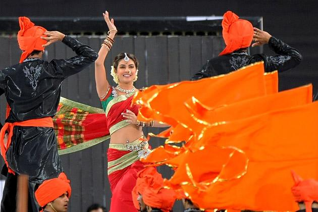 Bollywood actress Priyanka Chopra (C) performs during a ceremony before the IPL Twenty20 cricket match between Pune Warriors India and Kings XI Punjab at The Subrata Roy Sahara Stadium in Pune on April 8, 2012. AFP PHOTO/Punit PARANJPE (Photo credit should read PUNIT PARANJPE/AFP/Getty Images)
