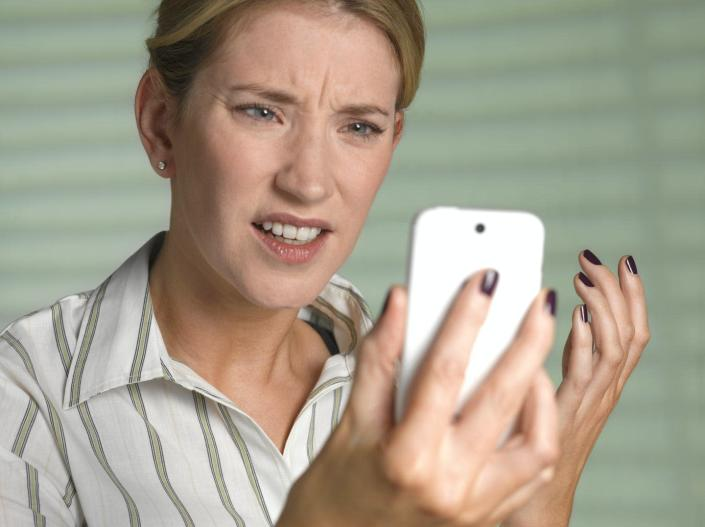 "<span class=""caption"">New research aims to give phone companies tools to help curb robocalls.</span> <span class=""attribution""><a class=""link rapid-noclick-resp"" href=""https://www.gettyimages.com/detail/photo/unhappy-woman-on-smart-phone-royalty-free-image/523191935?adppopup=true"" rel=""nofollow noopener"" target=""_blank"" data-ylk=""slk:Peter Dazeley/The Image Bank via Getty Images"">Peter Dazeley/The Image Bank via Getty Images</a></span>"