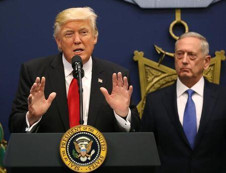 U.S. President Donald Trump dellivers remarks after attending a swearing-in ceremony for Defense Secretary James Mattis (R)  at the Pentagon in Washington, U.S., January 27, 2017. REUTERS/Carlos Barria