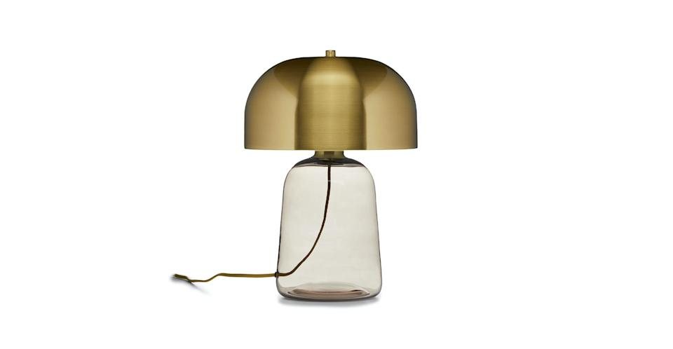"""<p><strong>Article</strong></p><p>article.com</p><p><a href=""""https://www.article.com/product/13685/koepel-brass-table-lamp"""" rel=""""nofollow noopener"""" target=""""_blank"""" data-ylk=""""slk:Shop Now"""" class=""""link rapid-noclick-resp"""">Shop Now</a></p><p><del>$159.00</del><strong><br>$149.00 ($10 off)</strong></p><p>Light up your home office or bedside tables with this chic brass lamp. The rounded lines make it feel less harsh than a traditional, block-like lamp, and the metallic lampshade will reflect light like no other. </p>"""