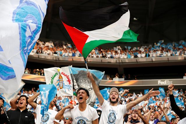 Soccer Football - Europa League Final - Olympique de Marseille vs Atletico Madrid - Groupama Stadium, Lyon, France - May 16, 2018 Marseille fans wave a Palestine flag inside the stadium before the match REUTERS/John Sibley