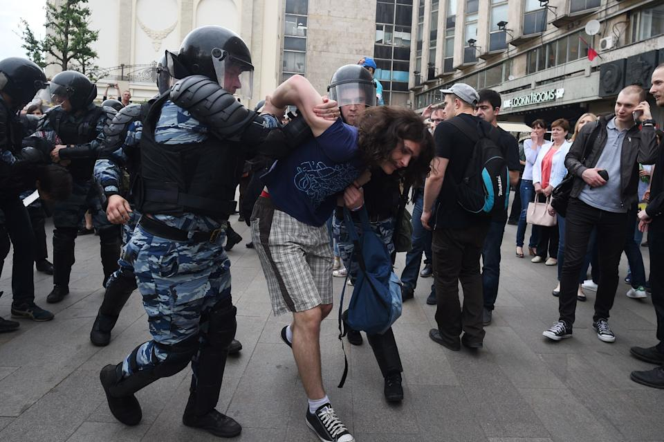 Russian police officers detain a participant of an opposition rally in Tverskaya street in central Moscow.