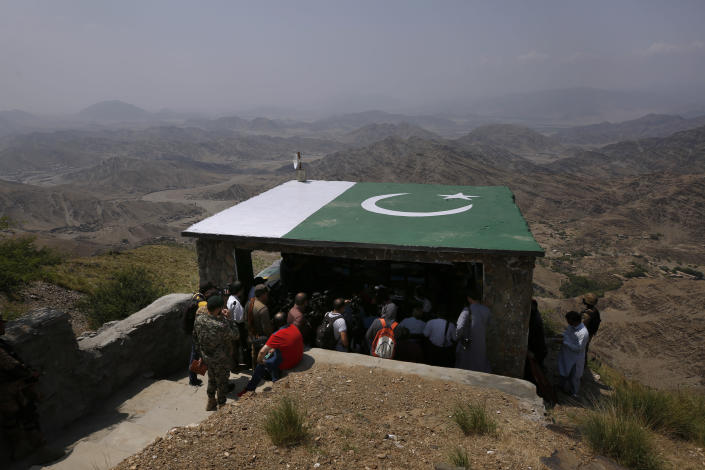 Members of International media attend a briefing during their visit to a hilltop post on the Pakistan Afghanistan border in Khyber district, Pakistan, Tuesday, Aug. 3, 2021. Pakistan's military said it completed 90 percent of the fencing along the border with Afghanistan, vowing the remaining one of the most difficult tasks of improving the border management will be completed this summer to prevent any cross-border militant attack from both sides. (AP Photo/Anjum Naveed)