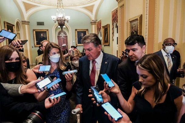 PHOTO: Sen. Joe Manchin speaks with reporters on Capitol Hill in Washington, on July 27, 2021. (Michael A. Mccoy/The New York Times via Redux)