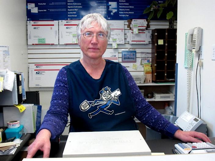 In this photo taken May 15, 2012, in Hope, Alaska, Linda Graham, the postmaster in Hope, discusses the U.S. Postal Service's plan to cut the rural Alaska post office's hours. The nearly bankrupt U.S. Postal Service is moving ahead with plans to close dozens of mail processing centers, saying on Thursday it can no longer wait as Congress remains deadlocked over how to help. (AP Photo/Mark Thiessen)