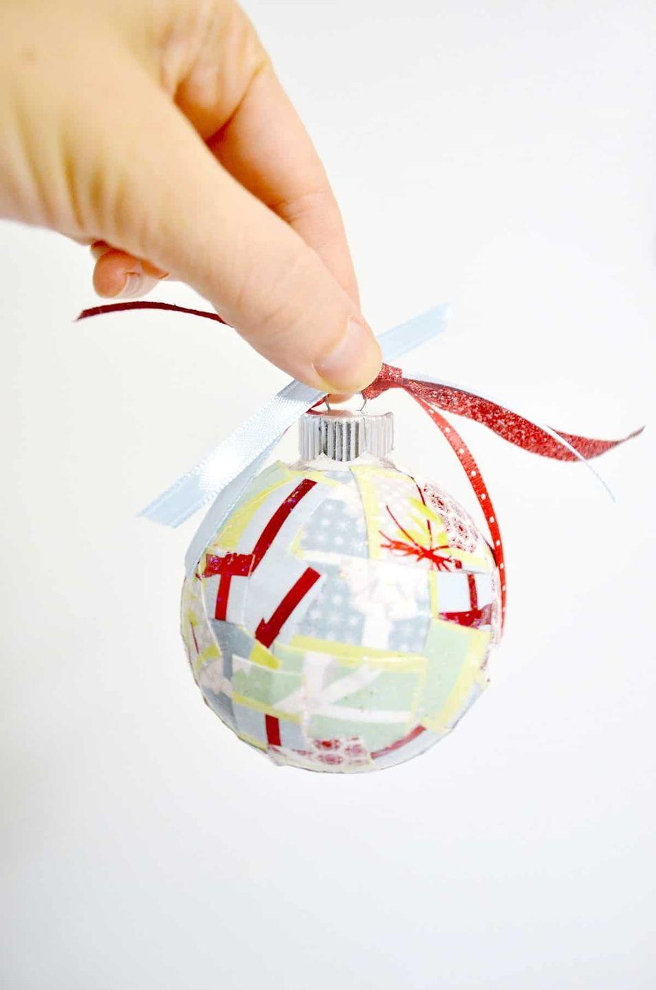 """<p>If you're trying to be more sustainable this holiday season, look no further—these DIY ornaments take all of your holiday wrapping scraps and turn them into something you'll use for years to come.</p><p>Get the tutorial at <a href=""""https://modpodgerocksblog.com/easy-paper-scrap-diy-christmas-ornaments/"""" rel=""""nofollow noopener"""" target=""""_blank"""" data-ylk=""""slk:Modge Podge Rocks"""" class=""""link rapid-noclick-resp"""">Modge Podge Rocks</a>.</p>"""