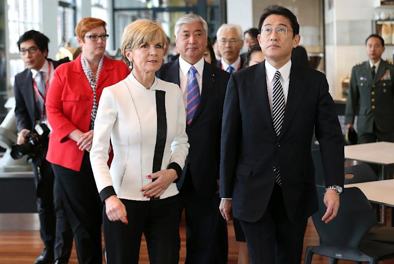 Australia's Foreign Minister Julie Bishop (L) walks with Japan's Foreign Minister Fumio Kishida during a visit to the Royal Australian Navy Heritage Centre in Sydney on November 22, 2015 (AFP Photo/David Moir)