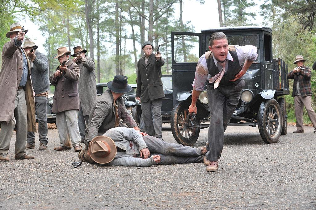 """""""<a href=""""http://movies.yahoo.com/movie/lawless/"""">Lawless</a>"""" (August 29): The Prohibition is the backdrop for John Hillcoat's tense, violent true-crime drama about Virginia brothers (Shia LaBeouf, Tom Hardy, and Jason Clarke) whose quiet homegrown moonshine business gets caught in the crosshairs of organized crime and a dandy of a Chicago lawman (Guy Pearce). Hardy's invincible elder brother hits hard, wastes few words, and steals scenes from pretty boy LaBeouf."""