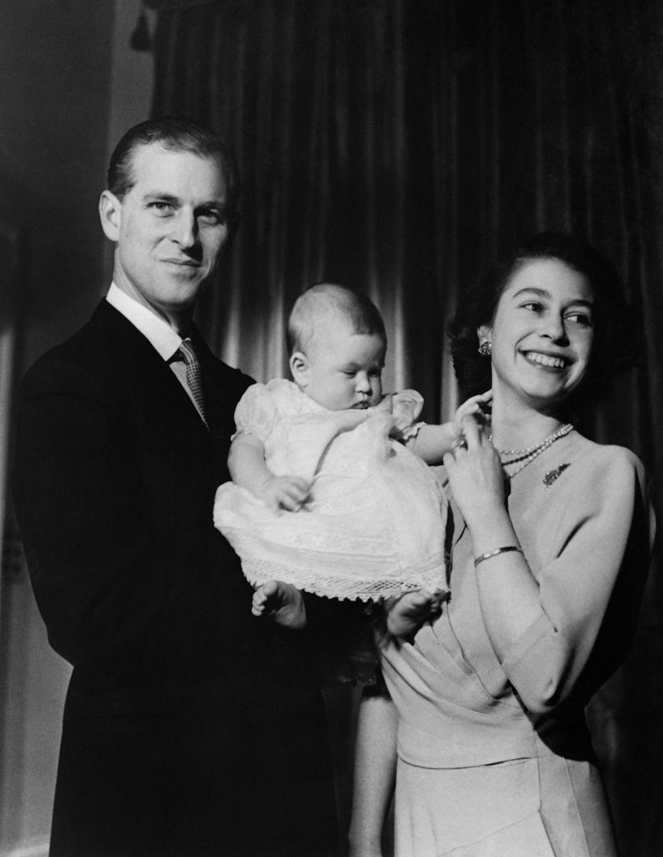 """<p>The future Queen Elizabeth II of England and Prince Philip, Duke of Edinburgh, posing with their son, <a href=""""https://www.goodhousekeeping.com/uk/fashion-beauty/a29827147/prince-charles-fashion-collection-net-a-porter/"""" rel=""""nofollow noopener"""" target=""""_blank"""" data-ylk=""""slk:Prince Charles"""" class=""""link rapid-noclick-resp"""">Prince Charles</a>.</p>"""
