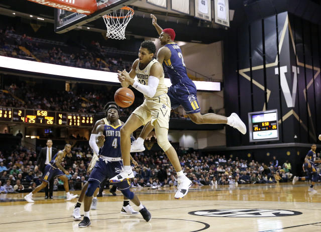 Vanderbilt forward Matthew Moyer (13) loses the ball as he fights for a rebound with Kent State forward BJ Duling (2) in the first half of an NCAA college basketball game Friday, Nov. 23, 2018, in Nashville, Tenn. (AP Photo/Mark Humphrey)